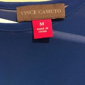 Vince Camuto Tops - Beautiful asymmetrical blue blouse.